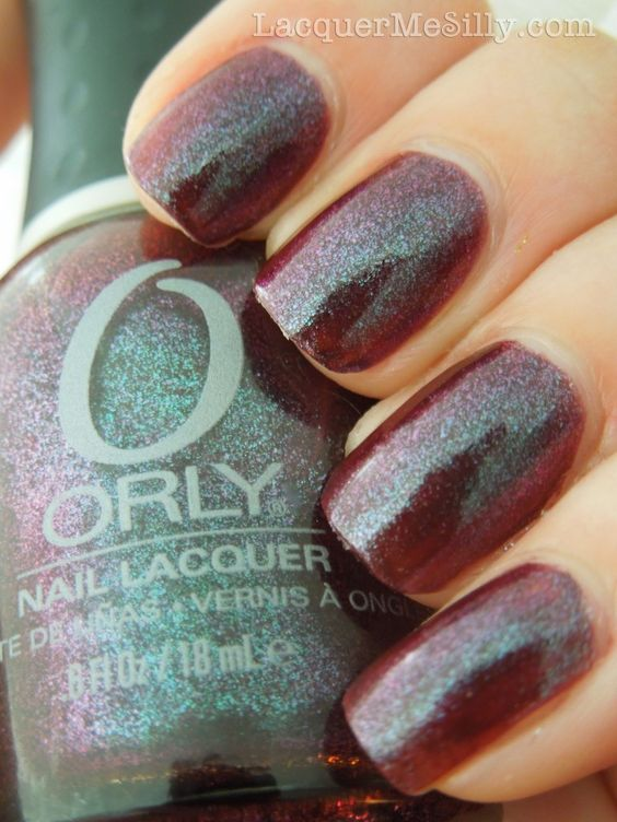 """Orly Galaxy Girl is a """"bruise"""" colored polish that shifts from a dark burgundy to purple, blue, and green. It makes me think of a texturized version of Orly Velvet Rope/ Mysterious Curse with more burgundy added to the multi-chrome effect."""