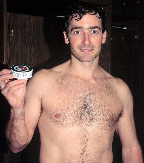 John Vanbiesbrouck posing with with the puck from his 300th NHL career win. (some eye candy for the older ladies)