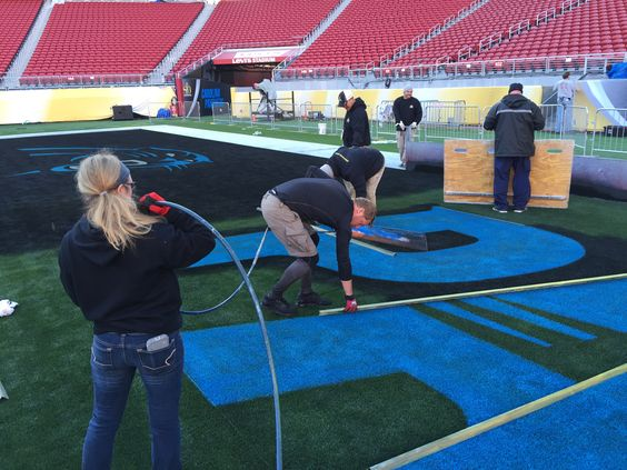 Painting the Panthers logo in the endzone at Levi's Stadium