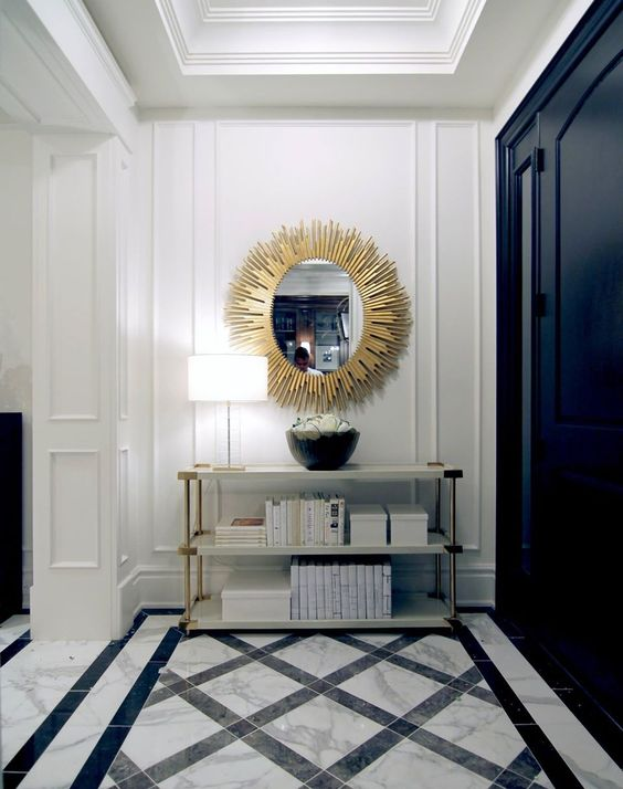 Entrance Hall With Statement Sunburst Mirror And Marble Tiles Featuring A Lat
