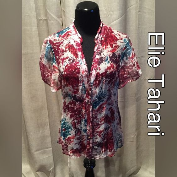 Elie Tahari sheer top Size tag has been removed but fits like a 4/6. Lightweight and sheer this is a great layering piece. Elie Tahari Tops