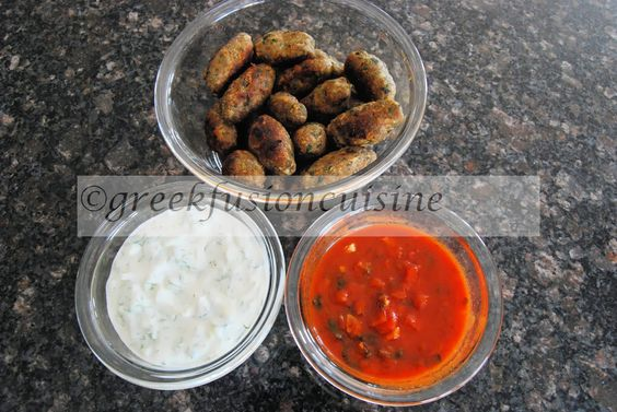 Smyrneika soutzoukakia from Smyrna as appetizers with tzatziki sause and domatosaltsa (tomato sauce).  Ground turkey sausages from Smyrna!