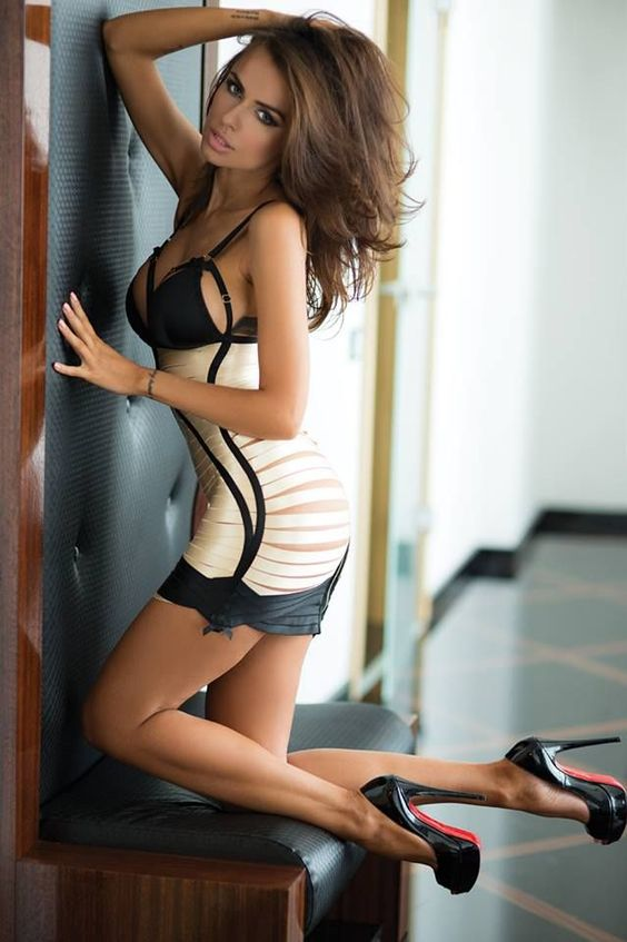 Gorgeous lingerie model with great legs wearing towering Louboutin high heels: