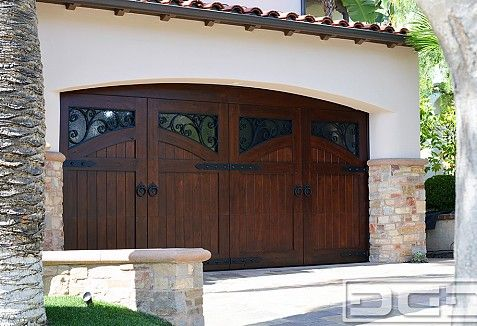 Custom Made French Mediterranean Style Garage Doors For Newport Coast Dynamic Garage Door Projects Custom Garage Doors Garage Doors Colonial Exterior