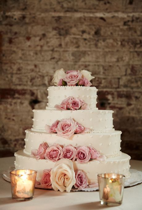 Brides.com: 32 of the Prettiest Floral Wedding Cakes. Four-tiered white wedding cake with fresh blush roses, by Spoonbread Catering.  See more classic wedding cakes.