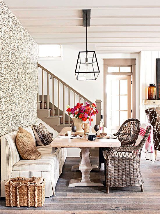 Flea Market Chic-Neutral Wicker Dining Chairs Blends Beautifully With The Banquette and Trestle Table.: