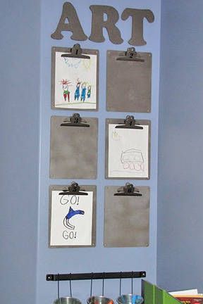 Love the idea of using clipboards (preferably brightly colored ones) to hang and rotate kids' art.