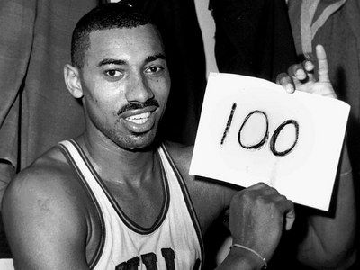 Wilt Chamberlain's 100 point game: Have sports fans forgotten. Chamberlain played for the Philadelphia Warriors (his home town).  His rookie season would be like no other, averaging 37 pts and 27 rebounds, forming an epic rivarly with Boston Celtic's Bill Russell.