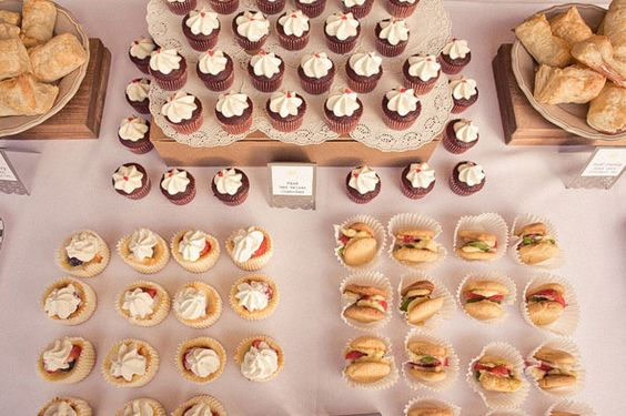 food layout. LOVE the cupcake holders with the mini sandwiches.
