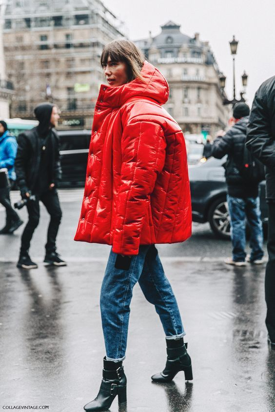 Red glossy puffa jacket worn back with straight frayed hem denim and pistol boots