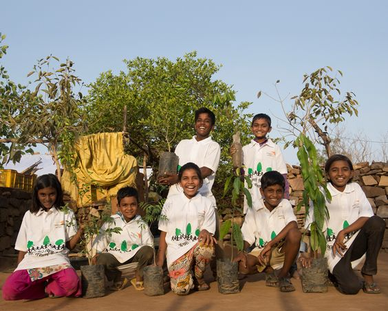 Children presented with a tree sapling from World Vision India as part of the climate change project in Baran, Rajasthan.