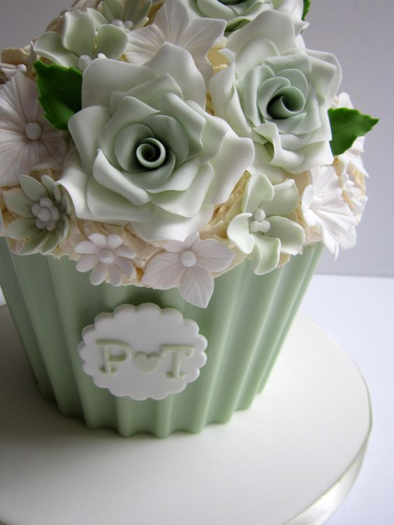 Pale green wedding giant cupcake #Mint / pastel green Wedding Reception ... Wedding ideas for brides, grooms, parents & planners ... https://itunes.apple.com/us/app/the-gold-wedding-planner/id498112599?ls=1=8 … plus how to organise an entire wedding ♥ The Gold Wedding Planner iPhone App ♥