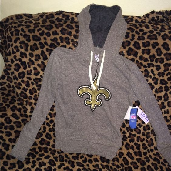 New Orleans Saints Zip-Up Hoodie Hoodie is still brand new, has tags. Size small. Color is gray, with a darker gray on the inside of the hood. Brand is Touch by Alyssa Milano. Touch by Alyssa Milano Tops Sweatshirts & Hoodies