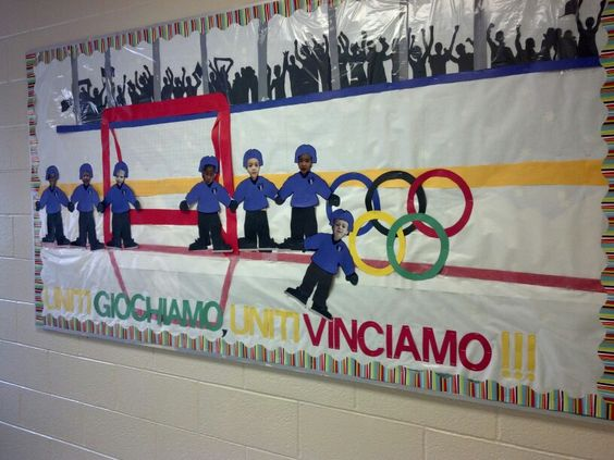 "Our pre K Olympics board. Wax paper over white was perfect looking""ice"" and fans were free handed cut shapes."