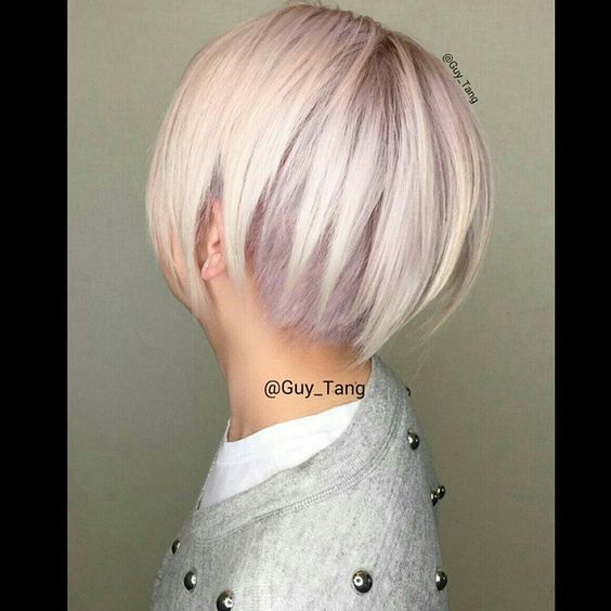 Short undercut blonde hair with purple undertone
