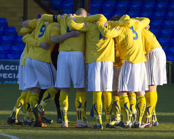 Warrington Town team huddle at the Doodson Sports Cup Final at Edgeley Park Stockport