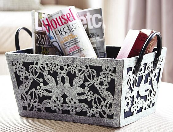 This intricate felt cut magazine basket is the ideal place to keep newspapers, magazines and books organised. Find more storage ideas at housebeautiful.co.uk