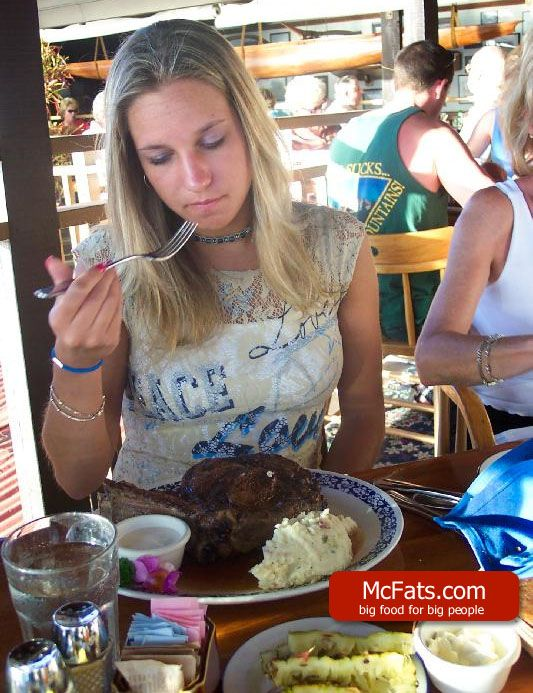 Girl with a giant steak