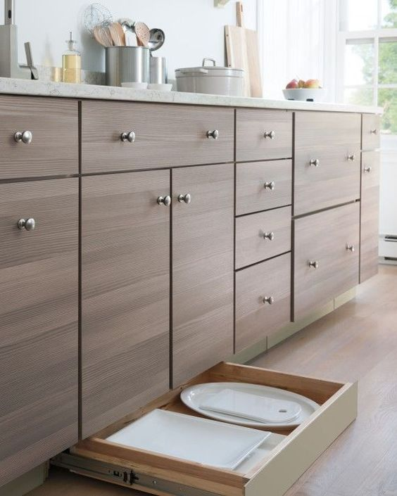 A toe-kick drawer fits beneath cabinetry, adding extra storage, and is perfect for housing large plates and platters.
