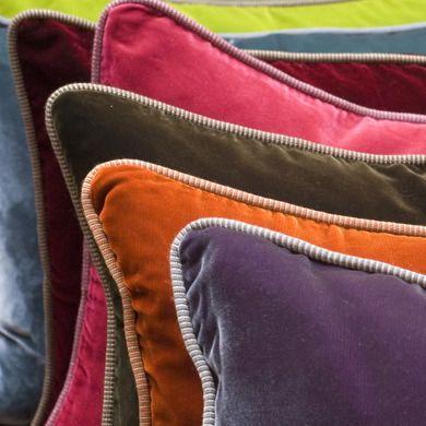 I love the pop of color the orange velvet pillow makes.: