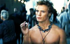 """(gif) no but finnick's expression in this scene is like """"take the sugarcube or i'll shove it down your throat"""""""