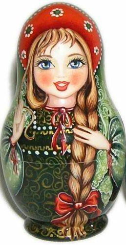 Matryoshka (Russian nesting doll) in beautiful kokoshnik (a headdress) with a long plait.