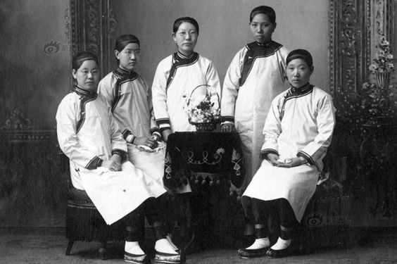 """""""This photo, taken in 1907, depicts a group of women who are graduating from a university in Beijing. While their clothes can still be considered Manchu in origin, there are notable difference that demonstrate how fashion had evolved. Here, the clothes not only exhibit Western influences, but are much more simple in terms of pattern and color."""""""
