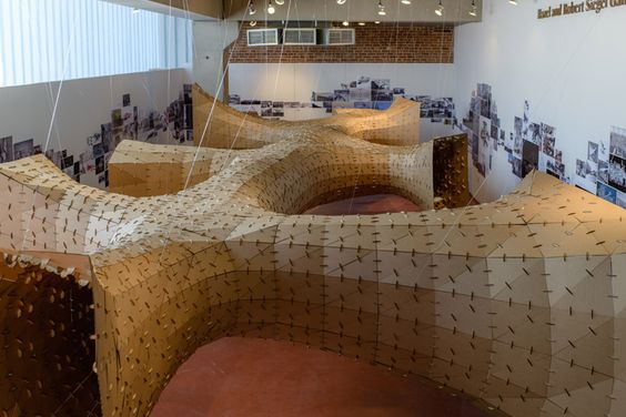created by a system of laser cut cardboard and thin plywood, the team made over 2,400 triangulated custom panels are interconnected  with 6,000 clips.