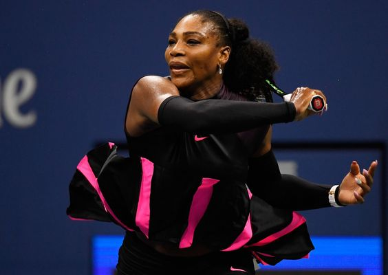 Serena Williams of the United States returns a shot to Simona Halep of Romania during their Women's Singles Quarterfinals Match on Day Ten of the 2016 US Open at the USTA Billie Jean King National Tennis Center on September 7, 2016 in the Flushing neighborhood of the Queens borough of New York City. (Source: Mike Hewitt/Getty Images North America)