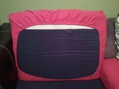 """DIY couch cushion """"slipcover"""", crib sheet style. I probably won't use curtains, but this looks easier and more efficient than covering the whole cushion and using a zipper."""