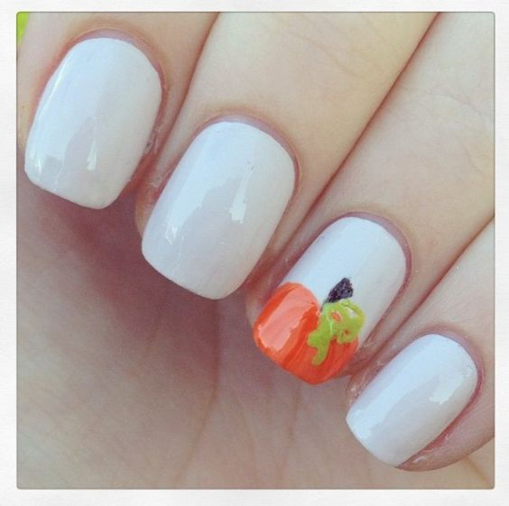 These pumpkin nail art looks are a cute way to look festive for Halloween.