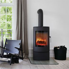 S50 Contemporary Free Standing - Morso Contemporary Stoves    S50 - a complete designed steel stove with a light sloping front.    The Morsø S50 is presented as an elegant and well-proportioned piece of furniture to dress any home. The slanting door gives the stove character and also accentuates the beautiful and generously-designed glass front.  The Morsø S50 is part of the new range of steel stoves, which aim to give a modern and unique expression.