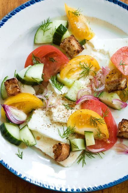 panzanella salad over fresh cheese