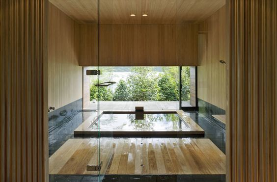 The Art of the Japanese Bath   Floating House between Sea and Forest  by Eiji Ueno / Oak Village.  Sliding glass doors slide open to reveal the corner of this home to the garden, and the bath can be used as rotenburo, traditional Japanese open-air bath.