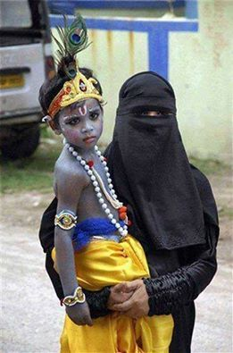 This happens only in India beautiful message. A Muslim woman holding her child dressed as a Hindu God Krishna.:
