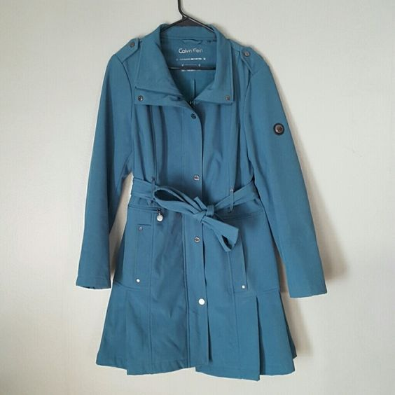 CALVIN KLEIN water resistant trench ruffle coat Adorable ruffle at bottom. Stretchy material. Perfect for spring! Fits a 10-14 size. Zipper and button enclosure. Calvin Klein Jackets & Coats Trench Coats