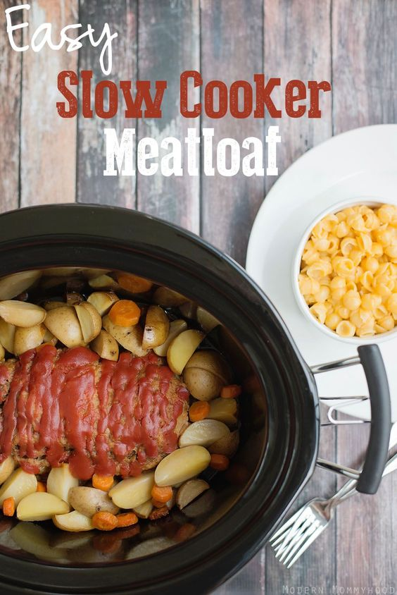 Easy Slow Cooker Meatloaf Recipe - Nothing beats an easy home cooked meal and this meatloaf is an easy crock pot meal for a busy day!  Made with crunchy panko crumbs and ketchup, it's delicious!