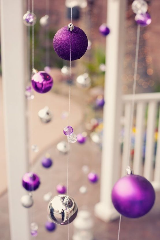 So easy yet such a stunning look - purple and silver Christmas ornaments hung from fishing wire