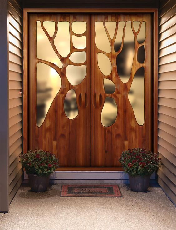 "I think this is a most beautiful front door.  From the site ""The two doors above are by artist and furniture designer Victor Klassen who we showcased a few weeks ago.  The way he shapes wood, bending and molding it like clay, is something only a master woodworker can do.  Klassen's designs show a deep reverence toward nature and his doors are among my favourite pieces. "":"
