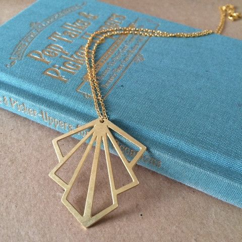 Gifts Ideas: gold necklace on a blue book