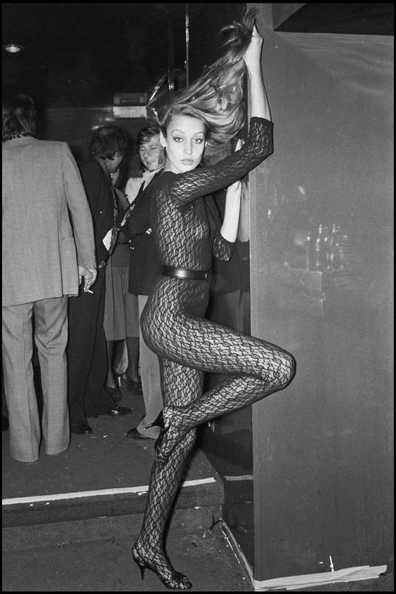 1970s Fashion Icons - Jerry Hall in a belted, skin tight lace leotard