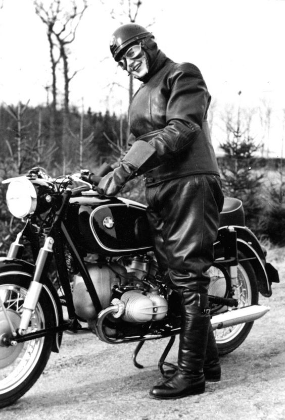 Lady motorcyclist wearing 1953 type of Swiss crash helmet