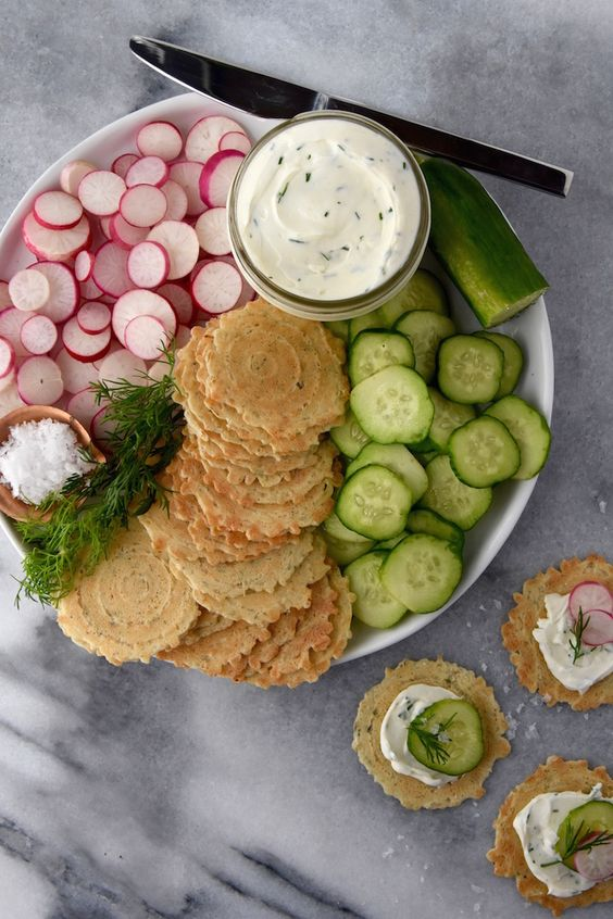 This simple combination of whipped dill cream cheese, crisps, fresh summer vegetables and flaky salt is a wonderful snack plate idea for summer.: