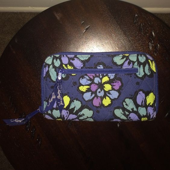 Vera Bradley Zip Wristlet Can function as either a wallet or a wristlet. Is the perfect size to use just as it is! Vera Bradley Bags Clutches & Wristlets
