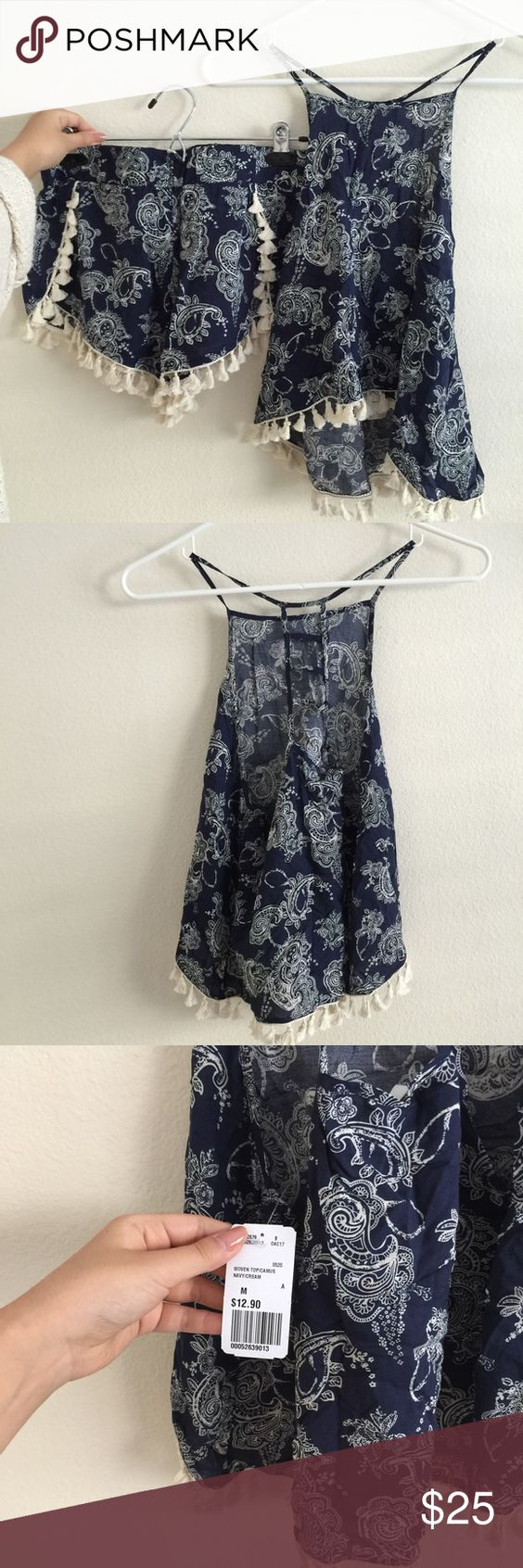 Paisley matching set PRICES FIRM UNLESS BUNDLED.   Fringed navy blue and cream matching tank top and shorts set. Tassels trim on both. Ladder cutout on tank top. Both size medium. Never worn. Tank is new with tags. Only selling as a set.   I DO NOT TRADE nor sell on other apps. Unfortunately I'm also unable to model my items. I'm a full time college student and don't have the time to do so. Please also understand if I'm a bit slow to respond to messages and provide measurements for the above…