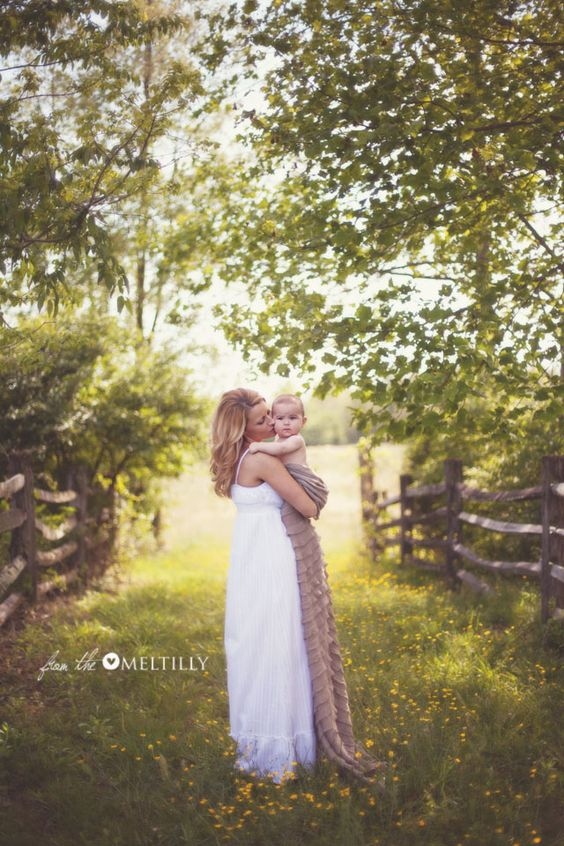 LOVE the simplicity of the white cotton dress and baby in blanket!