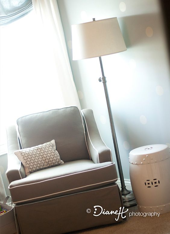 Modern gray glider and ceramic side table - love the look! #nursery