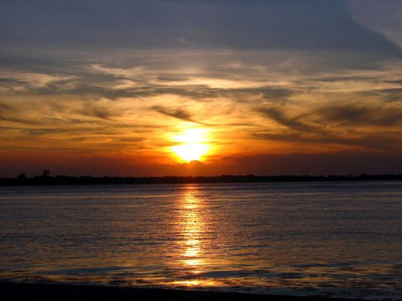 Sunset over ocean photograph by WaterDropletDesigns on Etsy