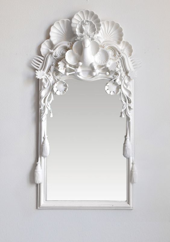 "Snow Bird 59""x32""Snow Bird 59""x32"" Snow Bird is a majestic mirror featuring the snow goose dressed in finery and crowned by a burst of shells. With its regal whimsy and classical form this mirror has a courtly presence."