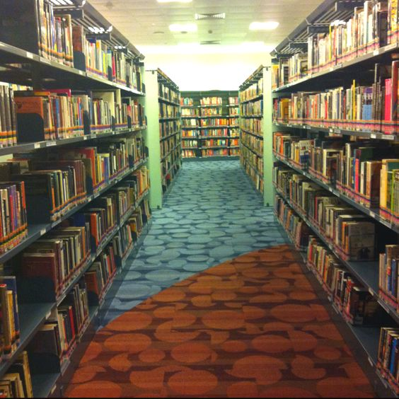Shhhhh.. I'm at the library...   I should come here more often.. Every book is screaming at me the most gentle possible way making me wanna pick them all up to read and digest them...